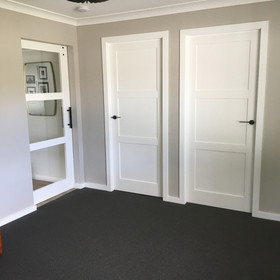White painted panelled doors in hamptons style