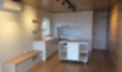 timber_walls_floors_modern_white_kitchen