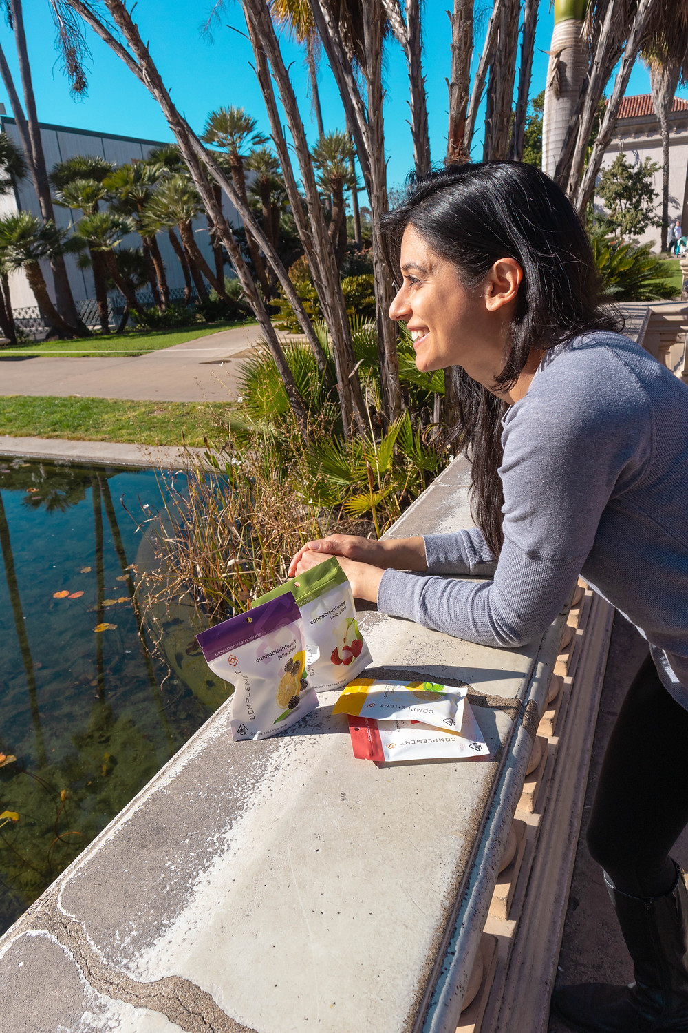 Founder, Jignasha Bhakta, at Balboa Park in San Diego with Complement Cannabis canna chewing gum and canna jello shots