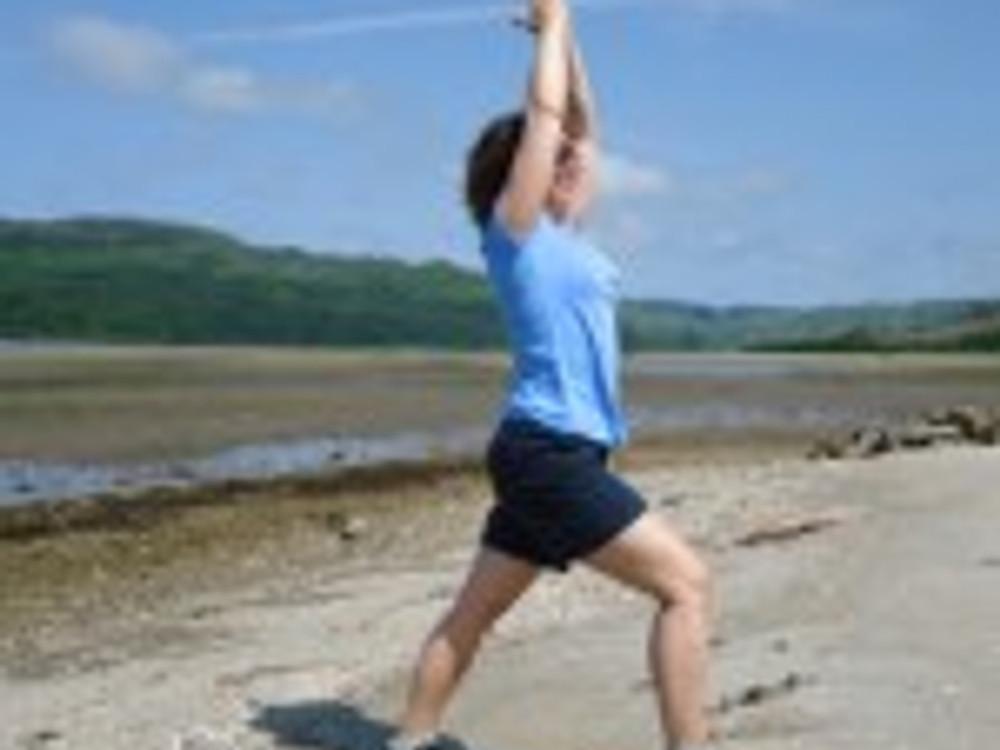 Warrior pose on the beach