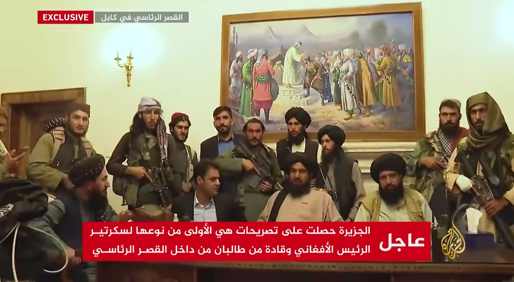 Several armed men from the Taliban pose in a still photo of a transmission by news channel Al Jazeera.