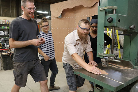 Todd uses bandsaw, group watches.JPG