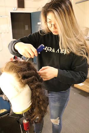 Girl combs wig excellent.JPG