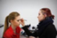 Nina applies makeup.jpg
