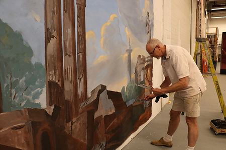 Philip paints at wall.JPG