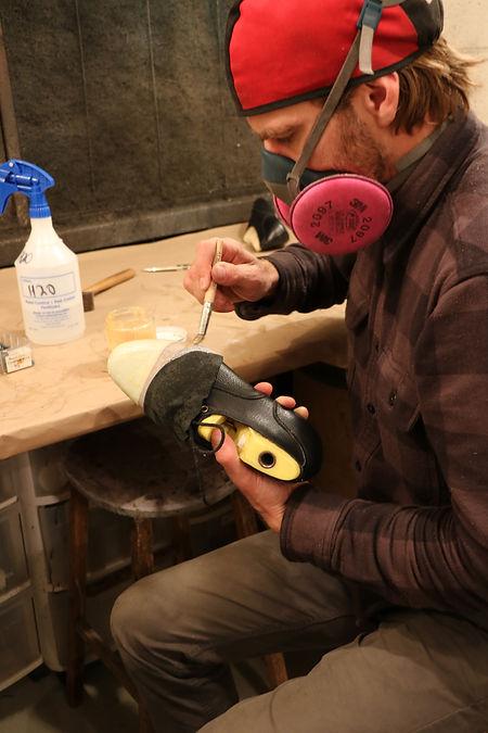 1 Adam applies glue to shoe 2.JPG