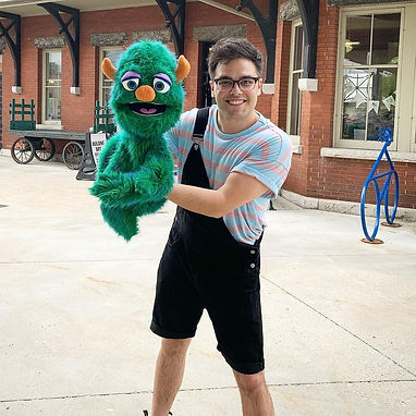Adam with Muppet style puppet.jpg