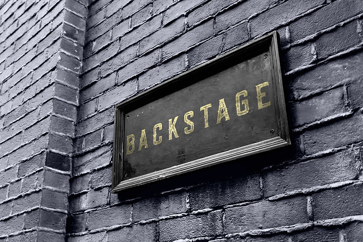 Backstage hanging signage wooden board. Business owner puts a golden black backstage sign..jpg