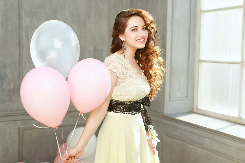 Happy teen girl in prom look with helium air balloons.jpg