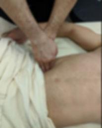 Two hands doing deep tissue massage