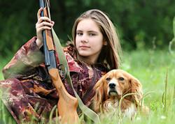 Female hunter with dog