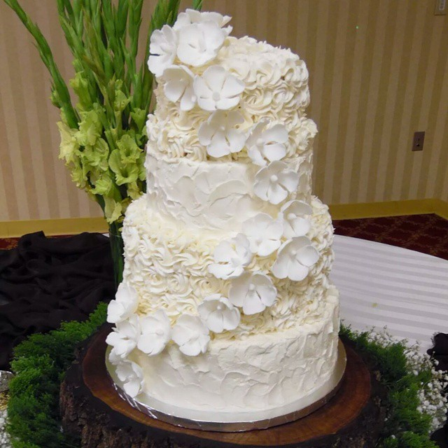 Four tier wedding cake_#KiasCakes #tieredcakes #SpecialDay #SugarFlowers #HePutARingOnIt #Decadence