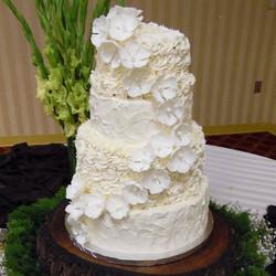 Four tier wedding cake_#KiasCakes #tieredcakes #SpecialDay #SugarFlowers #HePutARingOnIt #Decadence