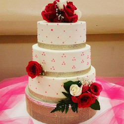 This weekend's wedding cake.jpg Vanilla, chocolate and sweet potato cake, gold accents and dark pink