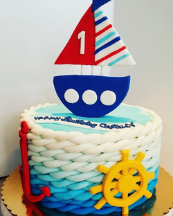 Nautical themed first birthday cake with