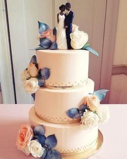 All buttercream wedding cake with fresh