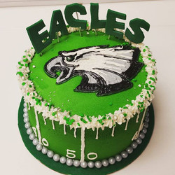 I heard they did well last night! Buttercream cake with hand painted buttercream Eagles logo