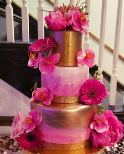Hot pink and gold birthday cake