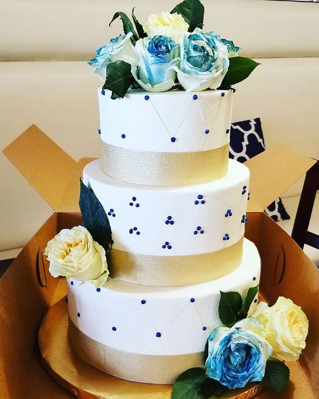 Blue and gold wedding cake with buttercr