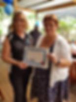 Village Rockers VP presenting Certificate