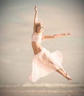 ballet dancer juming on the beach_edited.jpg