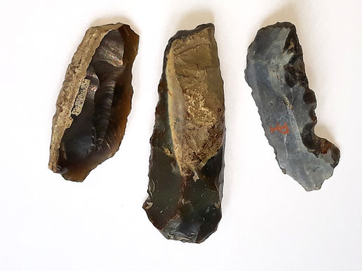 An image of 3 prehistoric stone tools made of flintl