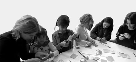 Image of a group of children participating in a craft activity at the Museum