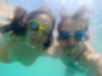 couple-having-fun-underwater-in-the-sea-