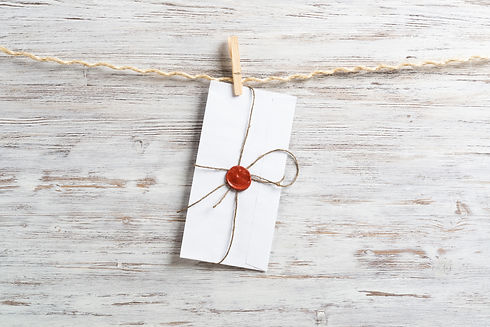 White classic envelope hanging on twine