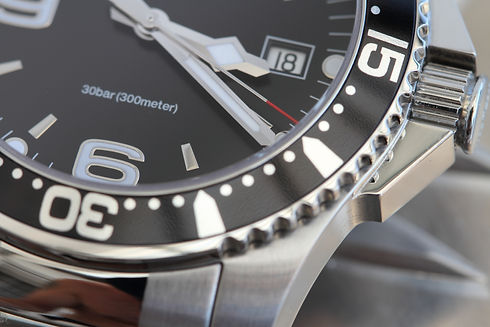 Diver watch with a metal bracelet.jpg