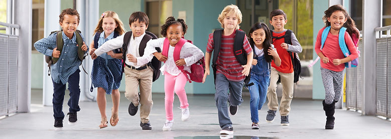 group-of-elementary-school-kids-running-in-a-schoo-PUCF4WE_edited.jpg