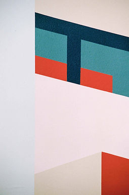 Detail of Coolmac graphic mural by ar–chive: Minimal architectural structures from Kirribilli in red, navy, teal and pink