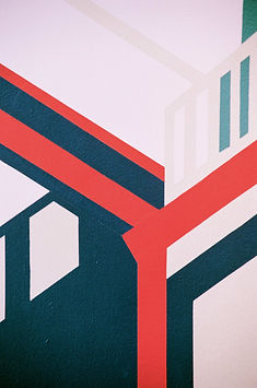Detail of Coolmac graphic mural by ar–chive: Minimal architectural structures from Kirribilli in red, navy and pink