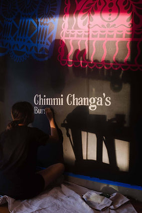 """Process of Chimmi Changa's graphic mural by ar–chive: Female artist hand lettering """"Burrito Bar"""""""
