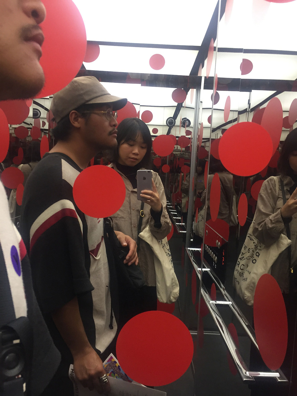 Angela and Rowland in the Yayoi Kusama Museum elevator surrounded by red circles
