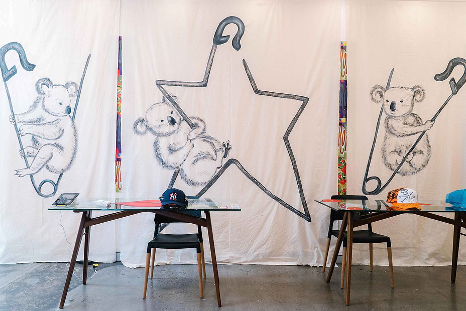 Wide view of M2 Gallery Surry Hills with three large koala artworks hanging across the wall