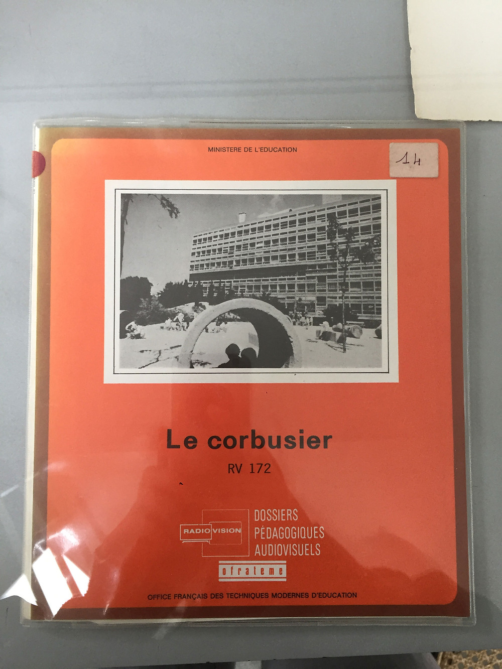 """Le corbusier red book titled """"RV 172"""" wrapped in plastic"""