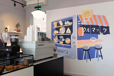 Bright blue and orange mural at Kurumac-the left side is a Japanese vending machine and right side is traditional ramen stall