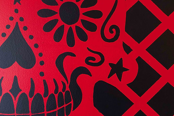 Detail of Chimmi Changa's mural: bright red Day of the Dead skull