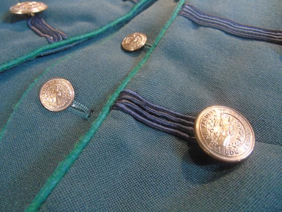 Close-up of the doorman's uniform