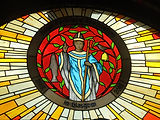 [9] stained glass window above the main