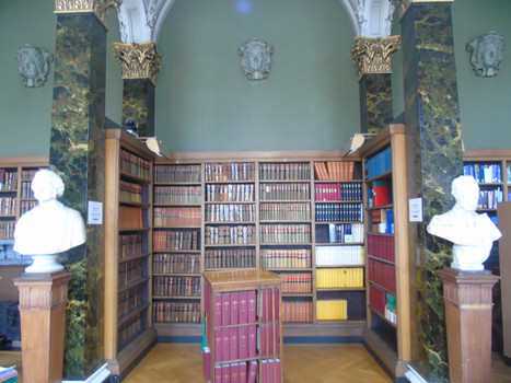Bay of shelves in the main library, featuring the marble busts of James Galbraith and James Roberton