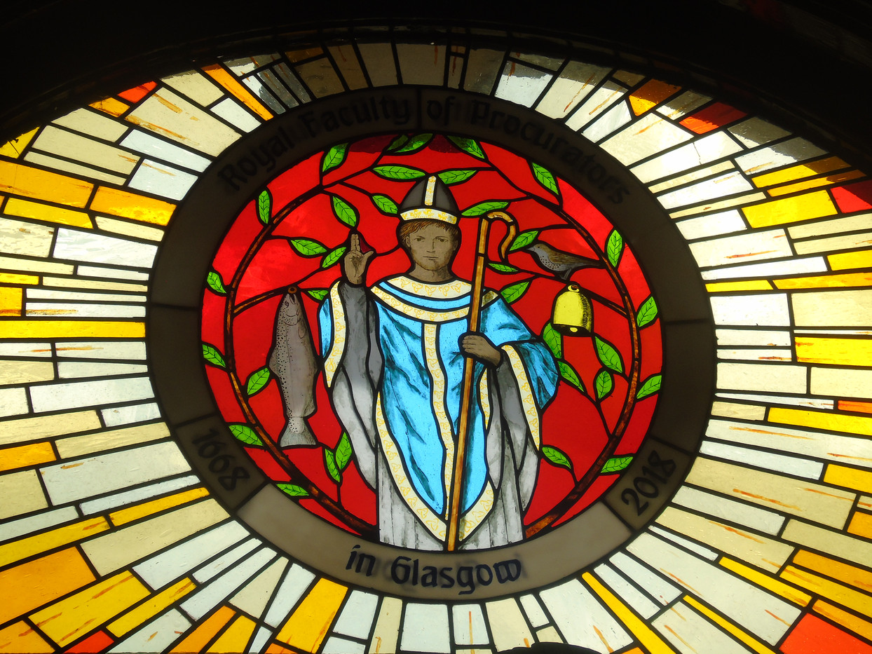 Stained glass featuring the Faculty crest