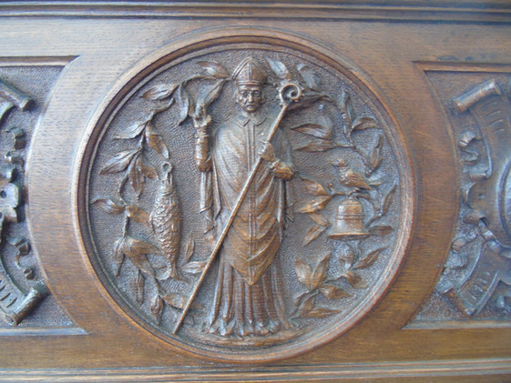 The crest of the Royal Faculty carved on the back of the Dean's Chair