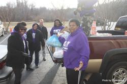Board Members Unload Food