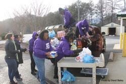 Members Unload donated Food