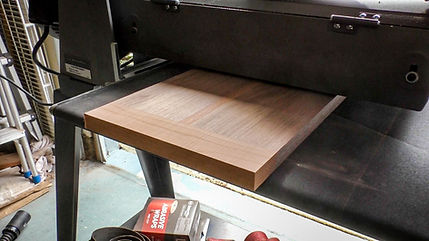 Running the cutting board through the drum sander