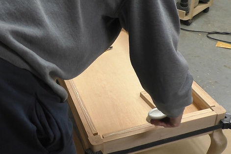 Photo of applying glue to the wooden strips