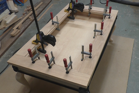 Photo of table top clamped to the wooden strips