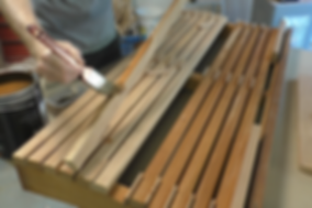 Photo of seat slats being pre-finished